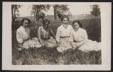Four girls sitting in grass